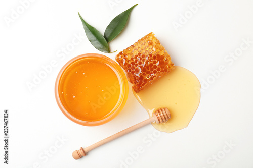 Composition with fresh honey on white background, top view