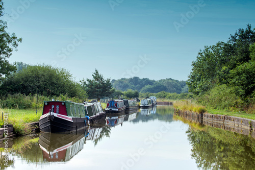 Leinwand Poster Moored narrow boats in the Cheshire countryside UK