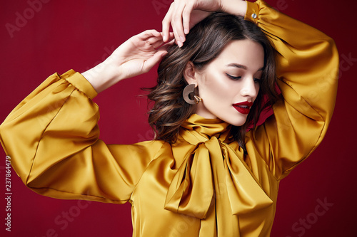 Portrait beautiful sexy pretty woman red lipstick jewelry earrings brunette hair cosmetic makeup fashion clothes beauty salon happy holidays merry Christmas Eve New Year St. Valentine's Day party.