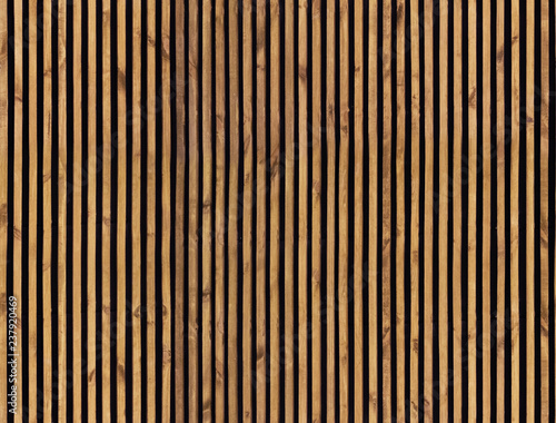 Fototapeta Seamless pattern of modern wall paneling with vertical wooden slats for background