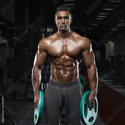 Tablou Canvas Muscular man working out in gym, strong arab male, naked torso abs