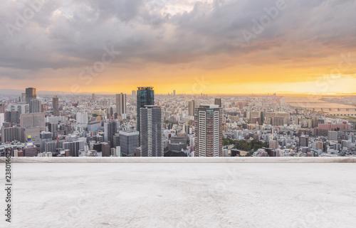 Fotografie, Obraz Osaka city skyline, downtown business district in sunset with empty concrete flo