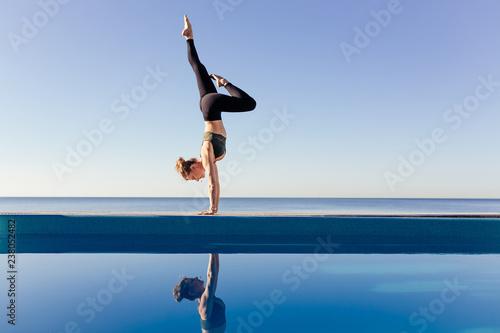 Canvastavla Young attractive woman practicing yoga doing Variation of handstand pose, Pincha Mayurasana