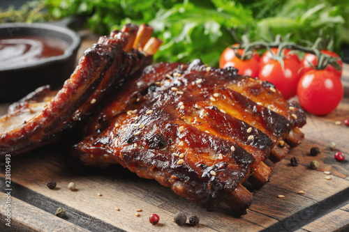 Fotografie, Obraz Closeup of pork ribs grilled with BBQ sauce and caramelized in honey