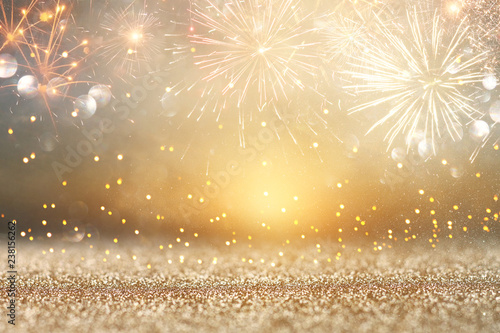 abstract gold glitter background with fireworks. christmas eve, new year and 4th of july holiday concept.