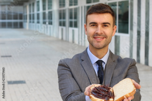 Businessman eating a high protein cockroach sandwich