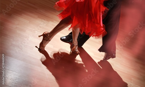 Fotografering Man and woman dancing Salsa on dark