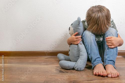 Stampa su Tela Sad depressed boy with teddy bear