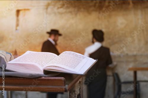 Fototapeta Jewish bible on table, wailing western wall, jerusalem, israel