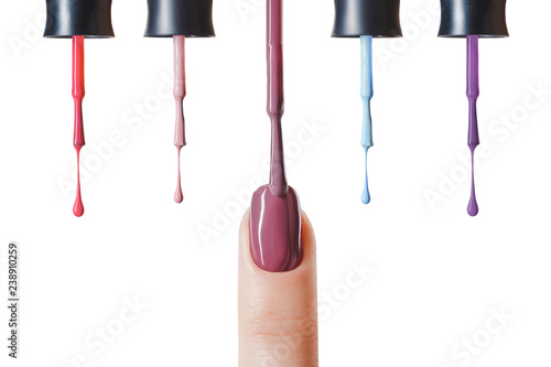 Canvas Print pastel nail polish on fingernail with wet brush isolated on white