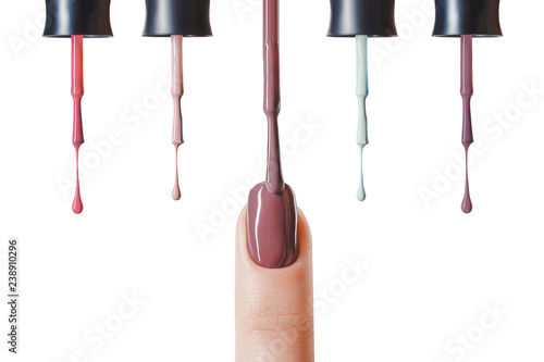 Wallpaper Mural brown nail polish on fingernail of woman with wet brush isolated on white