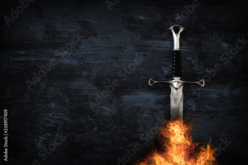 Wallpaper Mural low key image of silver sword in the flames of fire