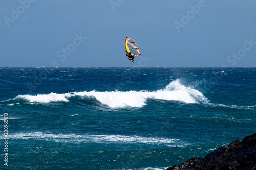 Wind surfing on the island's coast in the area of Costa Teguise