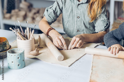 Stampa su Tela child working neatly with dough to make a ceramic object