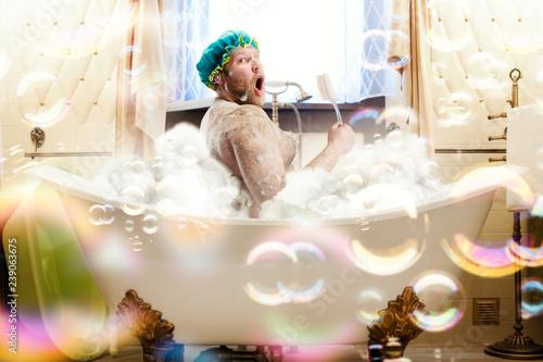 Leinwand Poster Fat ugly man washing in a bath