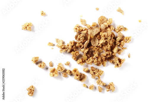 Crunchy granola, muesli pile with nuts isolated on white background, top view