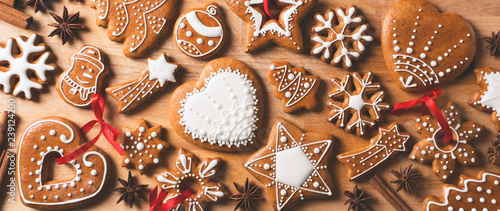 Gingerbread christmas cookies background on brown wooden texture
