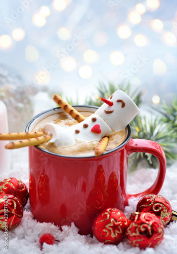 Red mug with cappuccino with melted marshmallow snowman