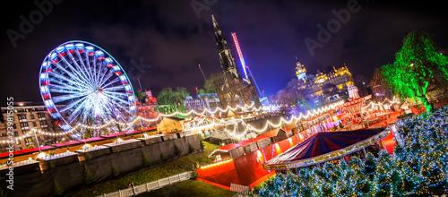Wide panoramic view of Edinburgh's Christmas market, rotated photo