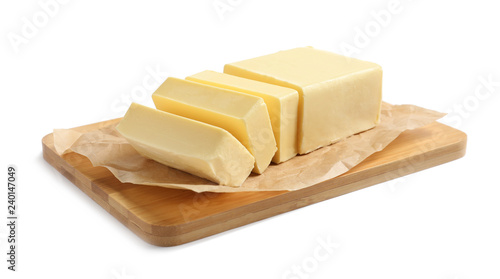 Wooden board with cut block of butter on white background