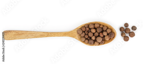 Fotografia Allspices or Jamaica pepper in wooden spoon isolated on white background