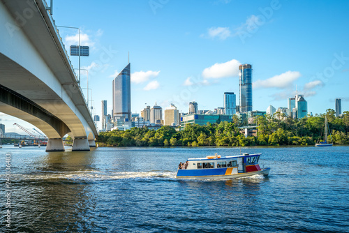 Wallpaper Mural ferry cruise on brisbane river with city skyline background