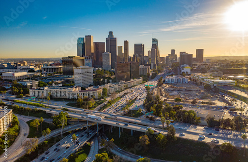 Fotografiet Drone view of downtown Los Angeles or LA skyline with skyscrapers and freeway traffic below