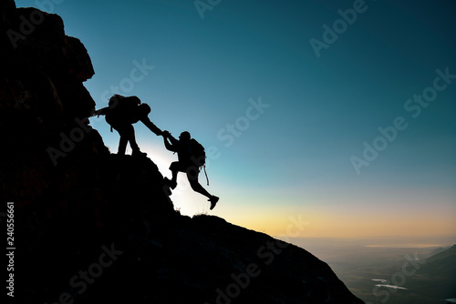 Obraz na plátně crazy climbers and help concept