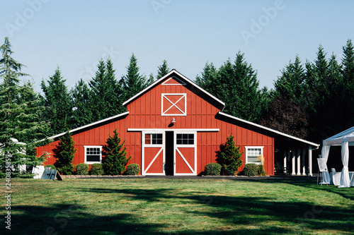Fototapeta large red barn during day