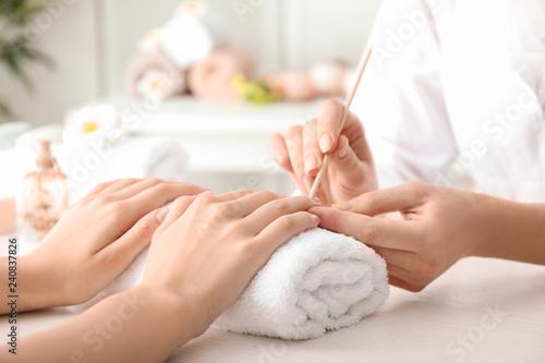 Young woman getting beautiful manicure in salon