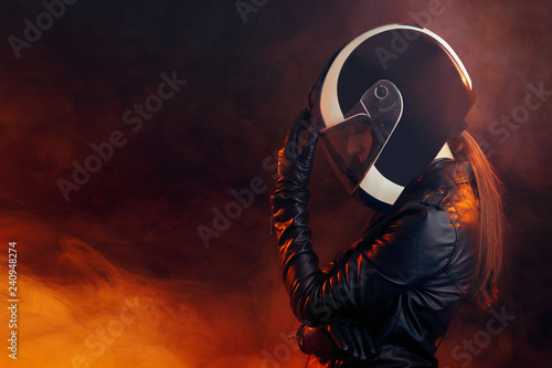 Fotomural Biker Woman with Helmet and Leather Outfit Portrait