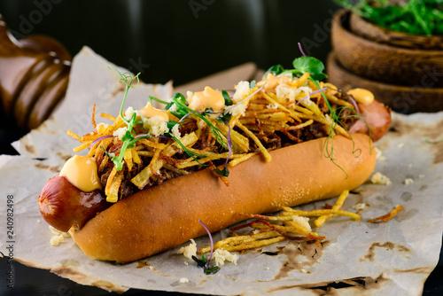 Fototapeta Delicious grilled hotdog in a restaurant