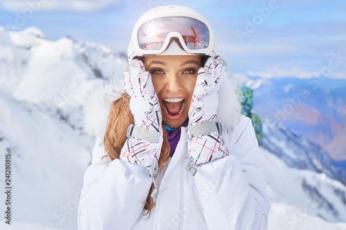 Canvas Print Close up portrait of a woman at a snow ski center.