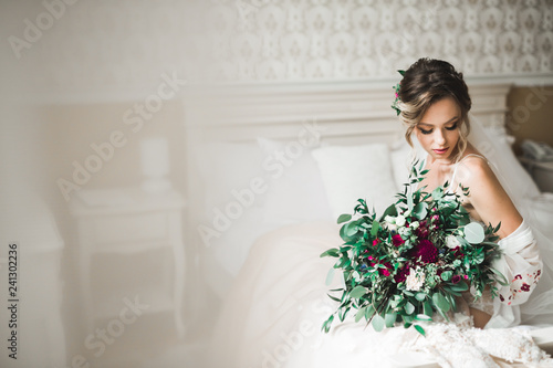 Valokuvatapetti Portrait of beautiful bride with fashion veil at wedding morning