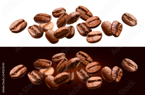 Fotografia Falling coffee beans isolated on white and black background