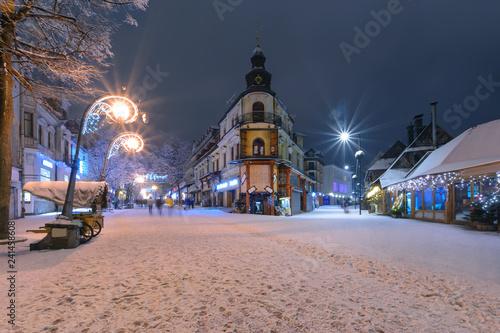 Main street in Zakopane in the snow evening