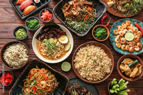 Canvas Print Assortment of Chinese food on wooden table