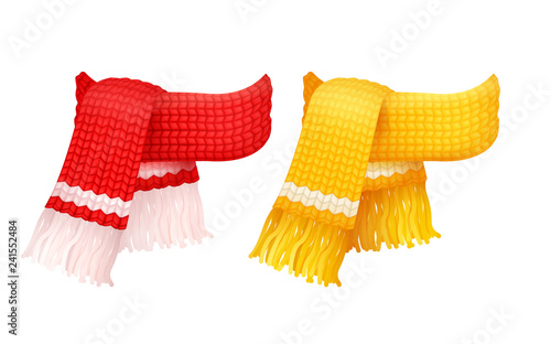 Obraz na plátne Yellow and red knitted scarf, white woolen threads