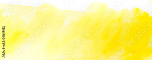 yellow watercolor stain drawn by hand. on paper with texture.