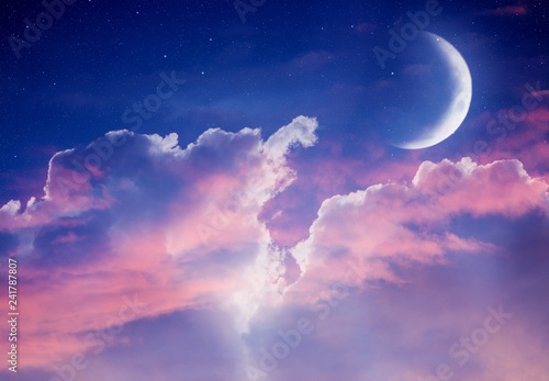 Ramadan dusk picture. Beautiful religious background with crescent, stars and glowing clouds.