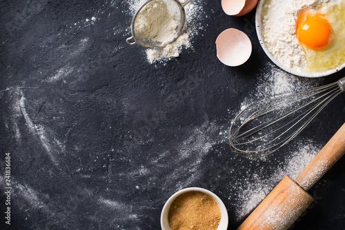 Cooking and baking utensils on black texture Fototapeta