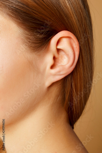 Detail of the head with female human ear and hair close up Fototapet