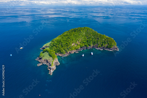 Carta da parati Aerial drone view of a remote, beautiful tropical island surrounded by coral ree