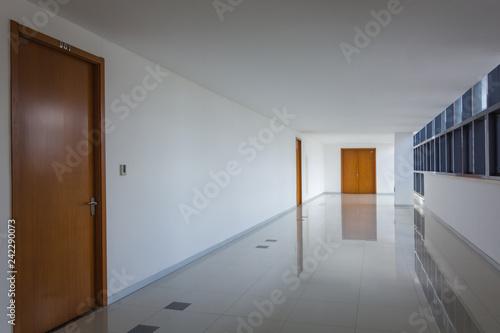 Carta da parati Illuminated long corridor in modern office building