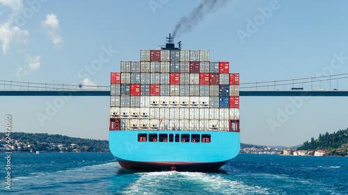 Photo Cargo ship tanker in Bosphorus Strait about to pass under Bosphorus bridge