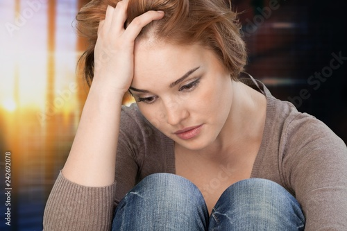 Vászonkép Young woman crying on background