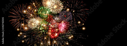 Fotografering Beautiful colorful fireworks  for celebration on dark background , New year holi
