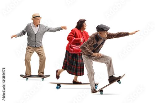 Group of seniors riding longboards