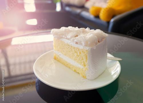Photo Cake slice cream vanilla cake slice on white plate - Coconut cake milk dessert o
