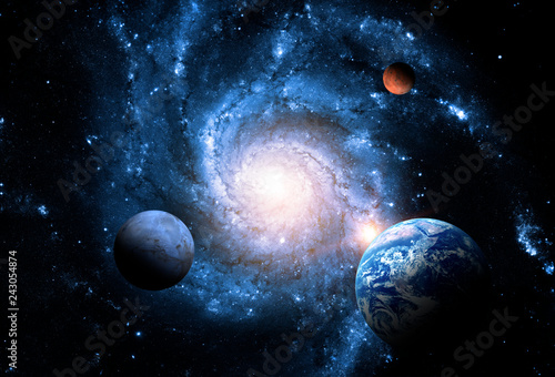 Obraz na plátně Planets of the solar system against the background of a spiral galaxy in space
